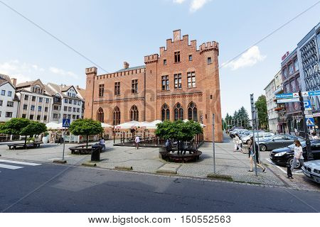 KOLOBRZEG POLAND - JUNE 23 2016: Side view of the neo-Gothic two-storey building of City Hall that was built between 1829-1832 it was slightly remodeled in 1913