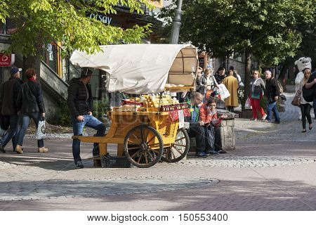 ZAKOPANE POLAND - SEPTEMBER 23 2016: The booth that offers Oscypek cheese was placed at the street Krupowki. Oscypek is Polish regional product since February 2007 and it is protected by EU law