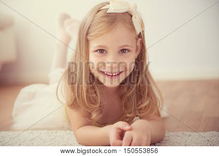 Smiling Pretty Ballet Girl In White Tutu In Studio
