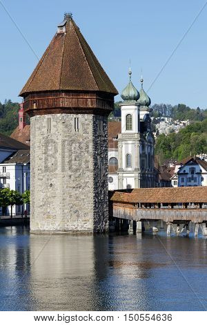 LUCERNE SWITZERLAND - MAY 05 2016: The octagonal tall tower was built in the river Reuss and together with roofed Chapel Bridge and the Jesuit Church there are the most recognizable city landmarks