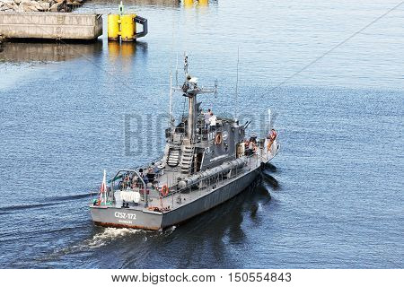 KOLOBRZEG POLAND - JUNE 22 2016: Torpedo boat decommissioned in 2001 and was later adapted for the sightseeing cruises it is shown how departs from port