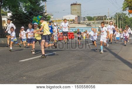 DNEPR UKRAINE- AUGUST 24, 2016: Kids running in Vyshyvanka Run during Independence Day local activity in Dnepr Ukraine at August 24 2016