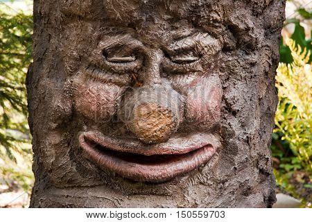 a tree with a face and closed eyes