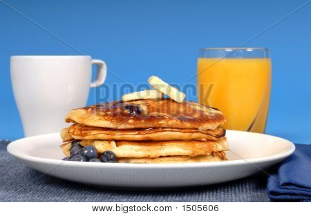 Blueberry Pancakes With Coffee And Orange Juice