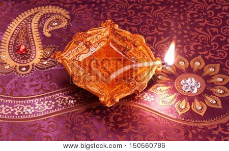 Handmade Diwali Clay Lamp on Floral Background