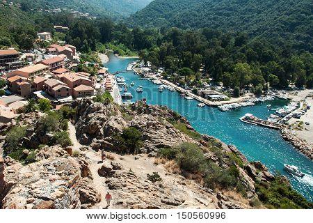 PORTO, CORSICA, FRANCE, AUGUST 28, 2016: View of the harbor of Porto, west coast of Corsica