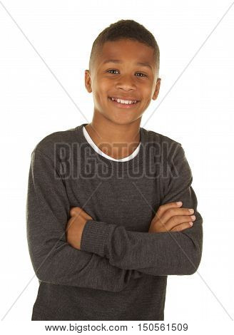Handsome Eleven Year Old Boy on White Background with his arms folded