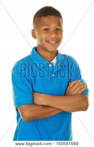 Handsome Eleven Year Old Boy on White Background with his Arms Crossed