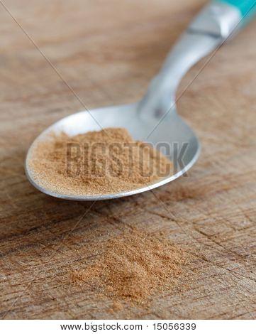 Cinnamon on a spoon on a bg