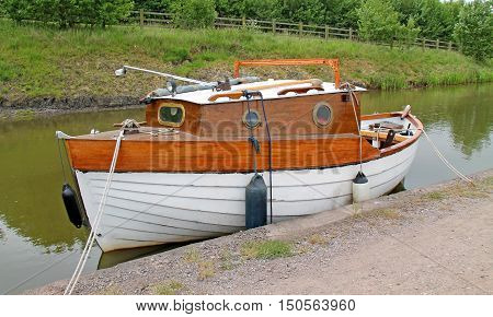 A Canal Trail Boat Moored at a Towpath.