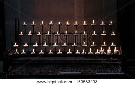 Prayer Candles Lit in a Quiet Part of a Church.
