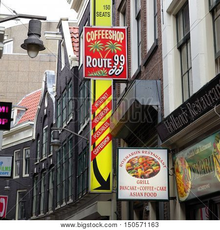 AMSTERDAM, HOLLAND - SEPTEMBER 9, 2011:  Street with sign of coffeeshop in Amsterdm