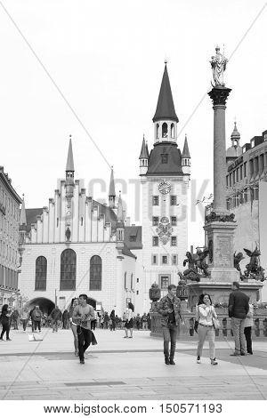 MUNICH, GERMANY - May 18, 2016: People on Marienplatz in Munich. Black and white image