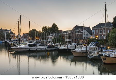 Dordrecht The Netherlands - September 13 2016: Harbor of Dordrecht Zuid-Holland The Netherlands with yachts and sail boats in evening light.