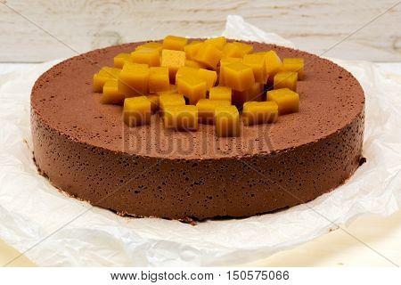 cheesecake cheese chocolate on white boards closeup