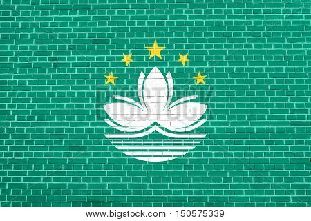 Macanese official flag. Patriotic chinese symbol banner element background. Macau is special region of PRC. Flag of Macau on brick wall texture background, 3d illustration