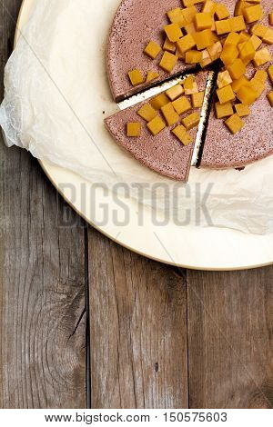 cheesecake cheese chocolate on old boards, flat lay