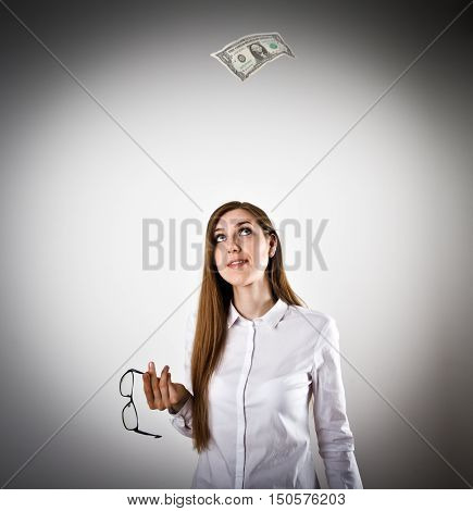 Woman in white and falling dollar banknote. One dollar concept.