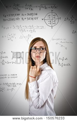 Woman in white is solving equation. Exam concept.