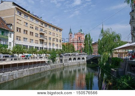 Old Town Embankment In Ljubljana With The Franciscan Church Of Annunciation. Slovenia