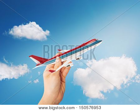 Toy airliner in flight on a sunny day. 3D Rendering