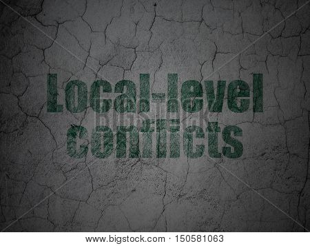 Political concept: Green Local-level Conflicts on grunge textured concrete wall background