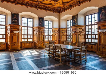 Augsburg, Germany - September 08, 2016: Famous Golden Hall in the historic town hall Augsburg, Germany with its coffered ceiling and portraits on the walls in a travel concept
