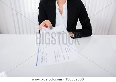 Photo Of Happy Businesswoman Offering Cheque In Office