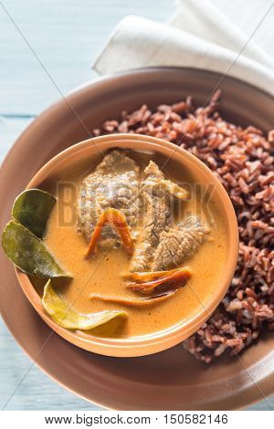 Portion of Thai panang curry with red rice