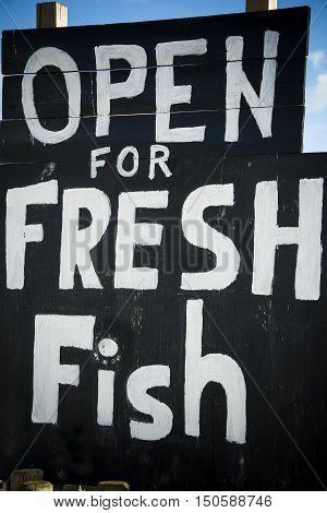 Fresh fish hand-painted sign at English seaside