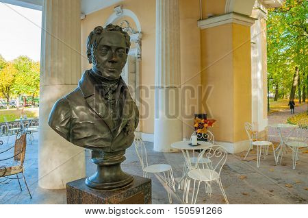 ST PETERSBURG RUSSIA-OCTOBER 3 2016. Rossi Pavilion in the Mikhailovsky Garden and the monument bust to Carlo Rossi - famous Russian architect of Italian origin in St Petersburg Russia