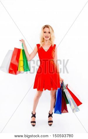 Full Portrait Of Beautiful Blonde In Red Dress With Paperbags