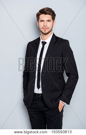 Handsome Bearded Man In Suit Holding Hands In Pockets