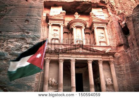 The Jordanian flag waves in the Treasury building at Petra.It's a symbol of Jordan as well as its most visited tourist attraction.