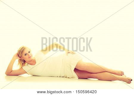 Subtlety and delicacy of women. Young fabulous stunning charming woman in white clothes. Casual beauty blonde lady.