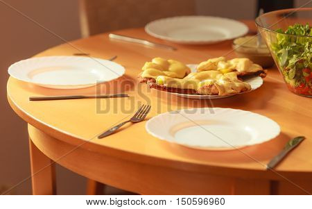 Chicken cutlet with pineapples and cheese on plate. Dinner dish meal ready to eat.