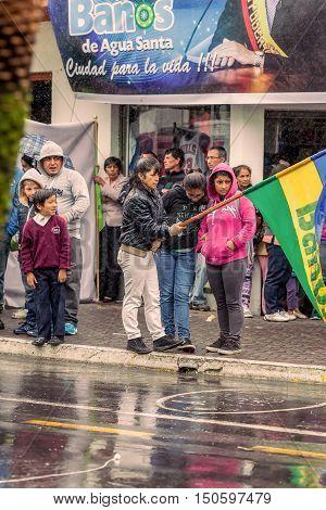 Banos De Agua Santa Ecuador - 23 June 2016: Group Of Families Waiting For The President Rafael Correa To Entering In Banos De Agua Santa Ecuador South America