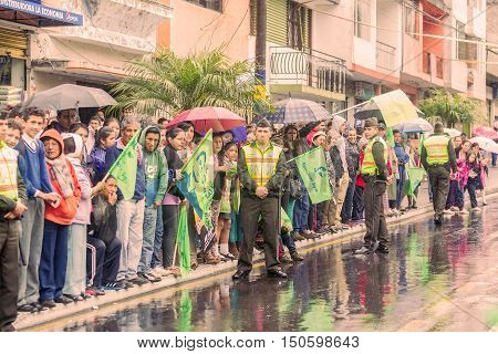 Banos De Agua Santa Ecuador - 23 June 2016: Group Of Supporters With Police Men Of Ecuador Waiting For The President Rafael Correa Delgado In Banos De Agua Santa Ecuador South America