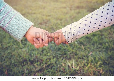 Multi-ethnic chidren holding hands for peace diversity friendship concept