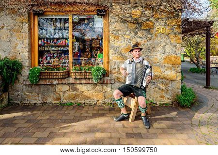 Hahndorf Australia - August 13 2016: Man playing accordion on the street near German Village Shop in Hahndorf Adelaide Hills area South Australia.