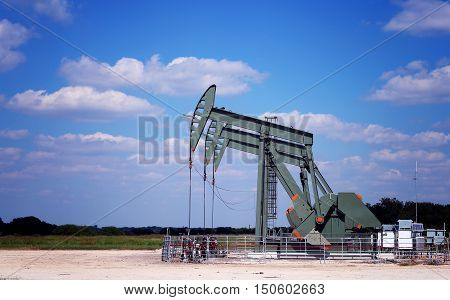 Oil Pumps on the field. Oil industry equipment.