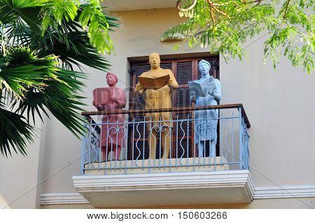 Statues on a balcony in Rothschild Boulevard in Tel Aviv Israel.