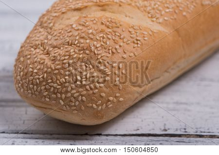 Sesame seed bread close up of end of the bun