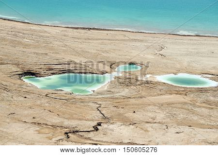 Sinkholes in the edge of the Dead Sea Israel.