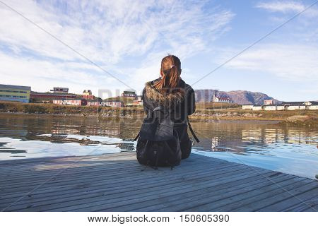 teen women get happy felling sit beside ocean beautiful city holding camera new technology. blue sky background by retro vintage present