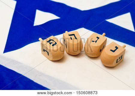 Israeli Flag With Wooden Dreidels