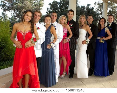 Group of Teenagers At the Prom - They are lined up in a row posing with happy smiles