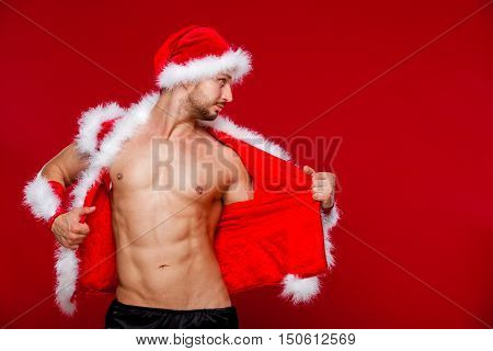 Sexy muscular man in santa uniform. Christmas New Year.