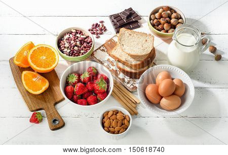 Allergy Food Concept. Allergic Food On A White Wooden Background