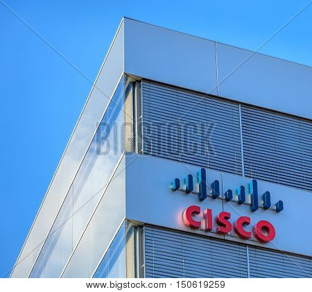 Wallisellen, Switzerland - 28 August, 2016: upper part of the Cisco Systems Switzerland office building against blue sky. Cisco Systems is a multinational technology company headquartered in San Jose, California.
